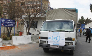 Truck carrying food aid from UNRWA make their way to besieged camp of al-Yarmouk, south of Damascus