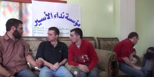ظهر المعتقلون لدى كتائب المعارضة المسلحة بصحة جيدة على خلاف المعتقلين لدى النظام