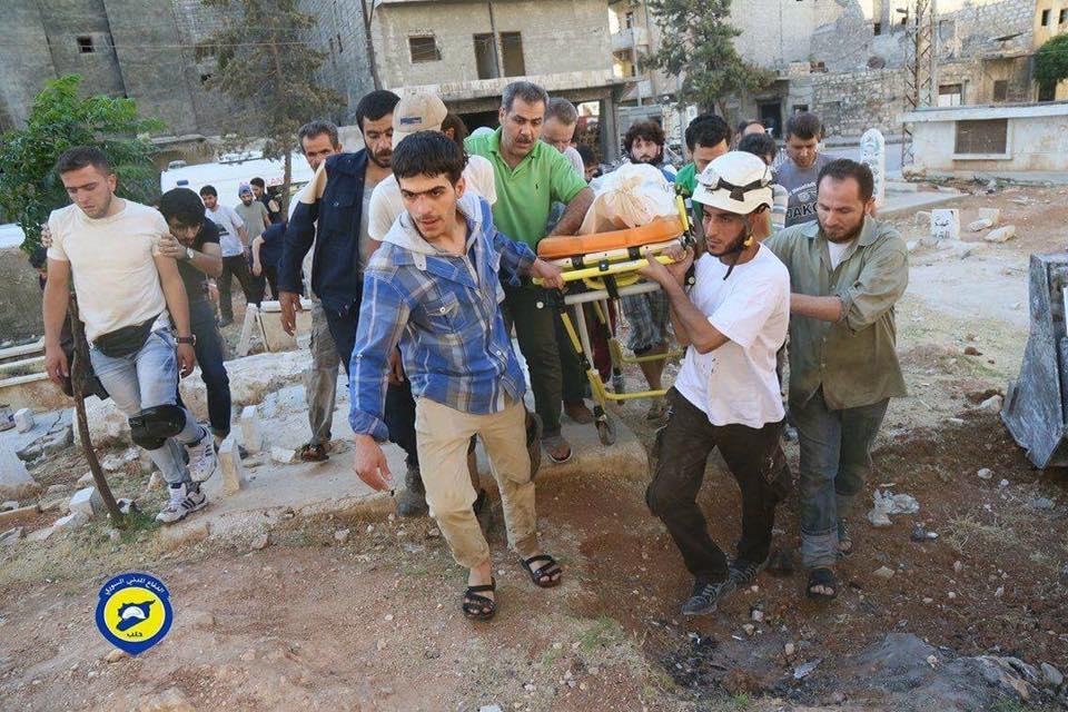 من مراسم تشييع عناصر الدفاع المدني في حلب يوم السبت