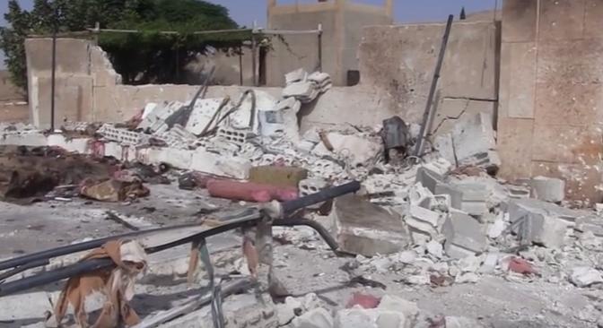 من آثار التفجير الانتحاري الذي استهدف بلدة الماشي